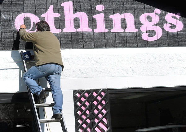 F. BRIAN FERGUSON/THE REGISTER-HERALD=Painting Sweet Nothings=Angelo Acosta, owner of Signimage, literally paints Sweet Nothings on the side of the business with the same name that is located on Ragland Road in Beckley.