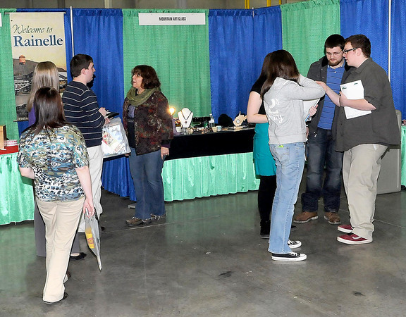 F. BRIAN FERGUSON/THE REGISTER-HERALD=Future employees check out some of the vendor booths during Thursday's Small Business Summit at the Advanced Technonlgy Center in Ghent.