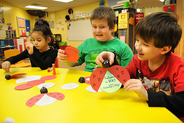 Maddison Greer, left, Adrian Mitchem and Joey Ansell, students at Stanaford Elementary School, work on Valentines they made for Veterans.<br /> Rick Barbero/The Register-Herald
