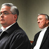 Mike Queen, left, and Doug Epling listening during the Raleigh County Commission meeting.<br /> Rick Barbero/The Register-Herald