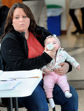 F. BRIAN FERGUSON/THE REGISTER-HERALD=Jessica Stover, of Oak Hill, holds her Granddaughter Ava Conner while Ava's mom, Sydni Stover, takes part in Sunday's College Goal at the Erma Byrd Center.