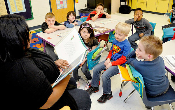 In celebration Black History month Paula Mitchell, a members of Delta Sigma Theta reads a  book to Bethany Donelow's kindergarden class at Beckley Elementary School on Friday. Photo by Chris Tilley