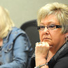 Pat Reed, Raleigh County Commissioner, listens to Doug Epling Speak during the commission meeting.<br /> Rick Barbero/The Register-Herald