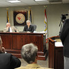 Doug Epling Speaks during the Raleigh County Commission meeting. Listening from left, Raleigh County Commissioners, Pat Reed, Dave Tolliver and Linda Epling.<br /> Rick Barbero/The Register-Herald