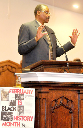 Coach Mel Coleman speaking  Sunday at The Heart of God Ministries in celebration of Black History Month. Photo By Chris Tilley