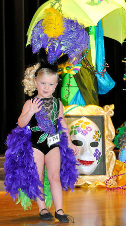 Harleigh Meadows walks on the the stage waving to the judges during the karnival Kuties pageant on Saturday at the Woodrow Wilson High School auditorium in Beckley. Photo by Chris Tilley