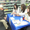 William White, of Beckley, speaks with Julie Brown, Alex Lawther and Megan McCluskey,  WVU pharmacy students, about the proper way to dispose drugs during the Drug disposal day at Colony Drug on Robert C. Byrd Drive in Beckley Monday afternoon.<br /> Rick Barbero/The Register-Herald