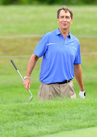Chris Collinsworth, reacts after almost chipping in from the sandtrap on the par 3 third hole Monday during The Greenbrier Classic Pro-am.<br /> Rick Barbero/The Register-Herald