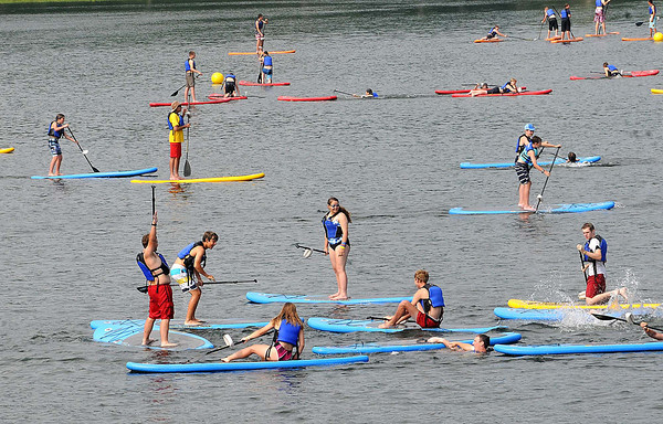 Scouts paddle boarding during the Boy Scout Jamboree Friday morning at the new Summit Bechtel Family National Scout Reserve near Glen Jean, WV<br /> Rick Barbero/The Register-Herald