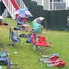 Few fans waiting for the rain to stop on the 18th green when was suspended due to inclement weather during the final round of The Greenbrier Classic Sunday on the Old White TPC Course at The Greenbrier Resort in White Sulphur Springs.<br /> Rick Barbero/The Register-Herald