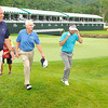 Gov. Earl Ray Tomblin, left, Gov, Steve Beshear, of KY, walk off the 18th green duriing The Greenbrier Classic Pro-Am<br /> Rick Barbero/The Register-Herald