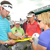 Bubba Watson signs autographs on the 18th hole during The Greenbrier Classic Pro-Am.<br /> Rick Barbero/The Register-Herald.com