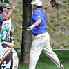 Johnson Wagner chipped in for eagle on the par 5 12th hole and gives his caddie the high five during the first round of The Greenbrier Classic Thursday on the Old White TPC Course at The Greenbrier Resort in White Sulphur Springs.<br /> Rick Barbero/The Register-Herald