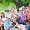 Crowd cheers after Ted Potter Jr. hit his tee shot on the 8th hole during the second round of The Greenbrier Classic Friday on the Old White TPC Course at The Greenbrier Resort in White Sulphur Springs.<br /> Rick Barbero/The Register-Herald