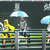 Spectators coming across the bride near the 18th hole while play was suspended due to inclement weather during the final round of The Greenbrier Classic Sunday on the Old White TPC Course at The Greenbrier Resort in White Sulphur Springs.<br /> Rick Barbero/The Register-Herald