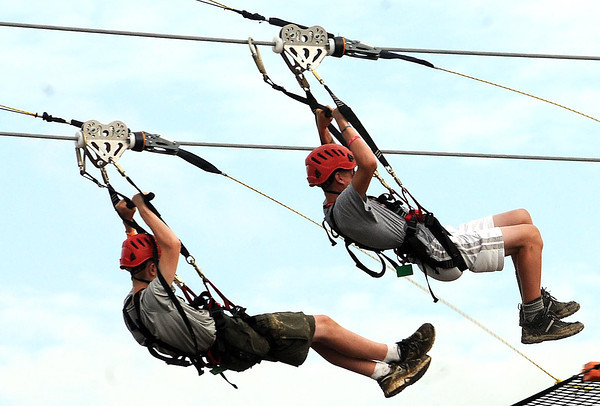 Scouts on the zip line during National Boy Scout Jamboree Monday morning at the new Summit Bechtel Family National Scout Reserve near Glen Jean, WV<br /> Rick Barbero/The Register-Herald