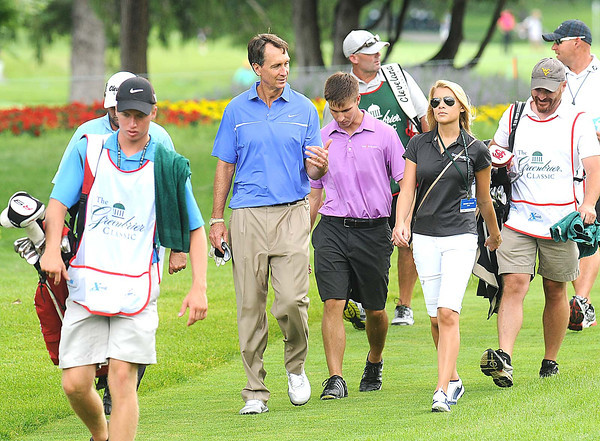 Chris Collinsworth walks up the third fairway Monday during The Greenbrier Classic Pro-am.<br /> Rick Barbero/The Register-Herald