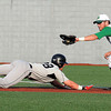 Griffin Moore, of West Virginia Miners, right, just misses tagging out, Billy Salem, of Lorain County Ironmen, at first base from a attempted pick off play Tuesday night at Linda K. Epling Stadium in Beckley<br /> Rick Barbero/The Register-Herald