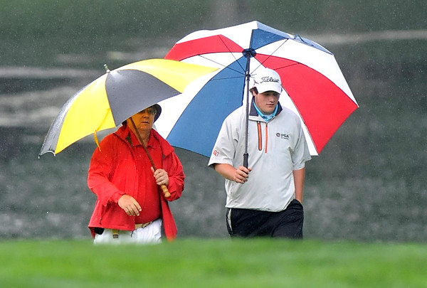 Roger Lilly, of Daniels, left, and Ian Illig, of Horne City Pa., walk on the 17th hole on the Cobb following Evam Muscari during the Greenbrier Classic pre-qualifer.<br /> Rick Barbero/The Register-Herald
