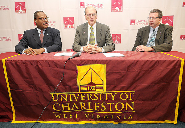 New River Community and Technical College President L. Marshall Washington, left, University of Charleston President Ed Welch, center, and U.C. Beckley President , Jerry Forster, right, sign a 2+2 agreement of Tuesday that would allow students from New River to easily transition into select bachelors degree programs at U.C. F.Brian Ferguson/The Register-Herald