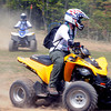 Jake Kurzhals, front, and Conor Russo, troop F606 from New York, ride ATV's during the National Scout Jamboree at the new Summit Bechtel Family National Scout Reserve in Mt. Hope, WV<br /> Rick Barbero/The Register-Herald