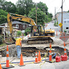 Beckley Sanitary Board employees working on fixing a sinkhole Piney Ave. in Beckley.<br /> Rick Barbero/The Register-Herald