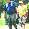 Jim Justice. chairman and owner The Greenbrier Resort, left, and John Daly walk up the third fareway Monday during The Greenbrier Classic Pro-am.<br /> Rick Barbero/The Register-Herald