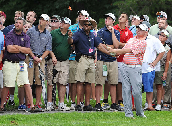 Ted Potter Jr. hit his second shot on the 9th hole during the first round of The Greenbrier Classic Thursday on the Old White TPC Course at The Greenbrier Resort in White Sulphur Springs.<br /> Rick Barbero/The Register-Herald