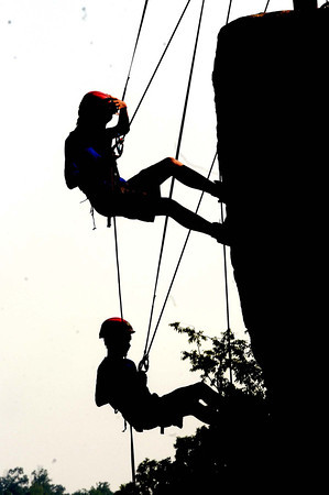 Silhouette of scouts rock climbing during the Boy Scout Jamboree Friday morning at the new Summit Bechtel Family National Scout Reserve near Glen Jean, WV<br /> Rick Barbero/The Register-Herald