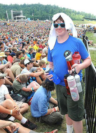 Craig Nance, troop A334, of Bellemont, N.C., goes after more water before the 3 Doors concert during the National Boy Scout Jamboree Saturday evening at the new Summit Bechtel Family National Scout Reserve near Glen Jean, WV<br /> Rick Barbero/The Register-Herald