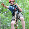 Andrew Tucker, troop B209, of California, rappel down a tree on the ropes challenge course during the National Boy Scout Jamboree Monday morning at the new Summit Bechtel Family National Scout Reserve near Glen Jean, WV<br /> Rick Barbero/The Register-Herald