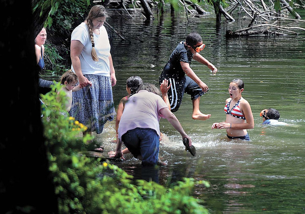 Parade goers cool off in the Greenbrier River at Alderson after taking in the town's annual July 4th Parade. F. Brian Ferguson/The Register-Herald