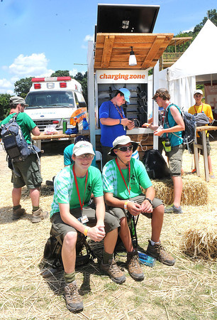 John Mihal, left, and Andrew Nelson, troop D347 from New Jersey, wait at the cell charging station fro there phones to charge at the new Summit Bechtel Family National Boy Scout Reserve in Mt. Hope, WV<br /> Rick Barbero/The Register-Herald