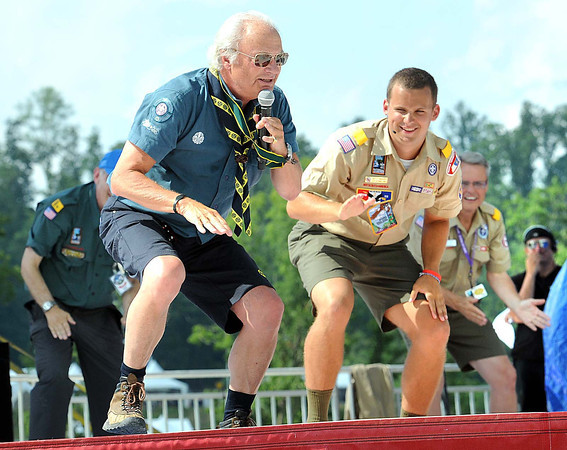 King Carl Gustaf XVI of Sweden, left, greeted the crowd enthusiastically during the National Boy Scout Jamboree Saturday evening at the new Summit Bechtel Family National Scout Reserve near Glen Jean, WV<br /> Rick Barbero/The Register-Herald