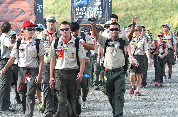 Alex Castro, troop A121 Rio Grande Valley Council in Texas, holds up the peace sign marching in with his troop friends for the opening ceremony of the National Scout Jamboree at the new Summit Bechtel Family National Scout Reserve in Mt. Hope, WV. <br /> Rick Barbero/The Register-Herald