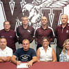 Woodrow Wilson Wrestler Cole Williams signs with Alderson-Broaddus, (from left front), father David Williams, Cole Williams, mother Ashley Williams, sister Emily Williams, (From left Rear), Retired Vice Principal Evert Mills, AD Tim Carrico, Vice Principal Eric Dillon, and Coach Chad Sarrett.F. Brian Ferguson/The Register-Herald