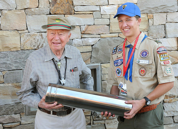 Stephen Bechtel, 50 million dollar donor, left, holds a time capsule with Garvin Hoffman, troop A127 during the Scout National Jamboree at the new Summit Bechtel Family National Scout Reserve in Mt. Hope, WV. <br /> Rick Barbero/The Register-Herald