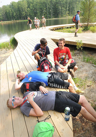 Daniel Smeraldo, troop B232, front, James Richardson, troop B401, Aakash Barevadia, troop B401 and William Stricklin, troop B401, of Dallas Texas take a short break  during the Boy Scout Jamboree Friday morning at the new Summit Bechtel Family National Scout Reserve near Glen Jean, WV<br /> Rick Barbero/The Register-Herald