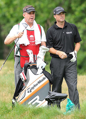 Sean Payton, coach New Orleans Saints, caddying for Ryan Palmer during the Greenbrier Classic Pro-Am<br /> Rick Barbero/The Register-Herald