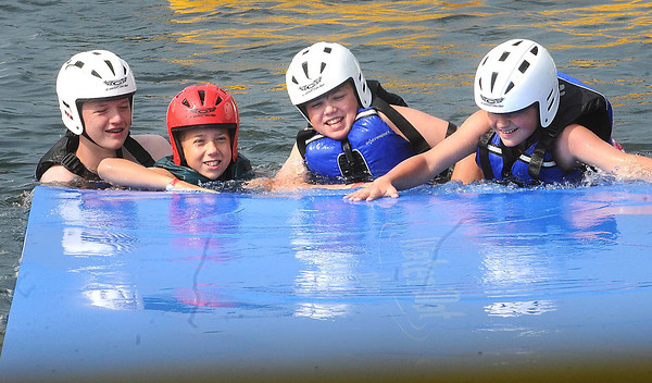 Scouts trying to get on a floating water pad at the challenge course during the Boy Scout Jamboree Friday morning at the new Summit Bechtel Family National Scout Reserve near Glen Jean, WV<br /> Rick Barbero/The Register-Herald