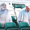 Zach Hughes, left and Brian Tucker, of Marietta, OH, seat in the bleachers on the 18th hole when play was suspended due to inclement weather during the final round of The Greenbrier Classic Sunday on the Old White TPC Course at The Greenbrier Resort in White Sulphur Springs.<br /> Rick Barbero/The Register-Herald