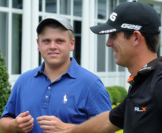 James Monroe High School golfer, Ike Judy, left, gets some tips from golf pro Billy Horschel, right,on tee #1, on the Old White course, during Monday's practice rounds of the Geenbrier Classic. F. Brian Ferguson/The Register-Herald.
