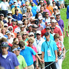 Crowd walking on the 6th hole during the first round of The Greenbrier Classic Thursday on the Old White TPC Course at The Greenbrier Resort in White Sulphur Springs.<br /> Rick Barbero/The Register-Herald