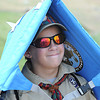 Brian Duff, welbo scout visitor from Austin, Tx, shades himself from the sun during National Boy Scout Jamboree Saturday afternoon at the new Summit Bechtel Family National Scout Reserve near Glen Jean, WV<br /> Rick Barbero/The Register-Herald