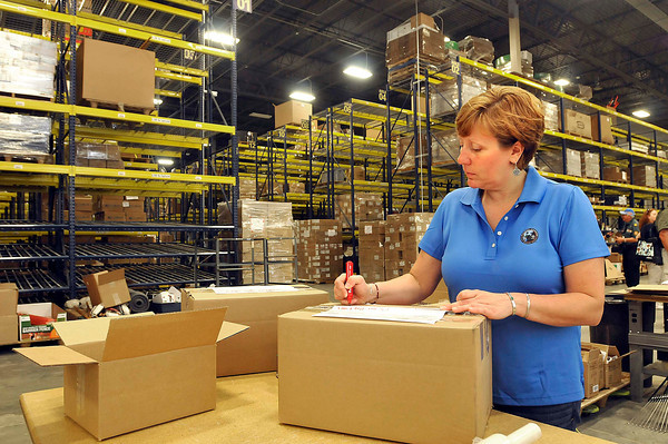 Brenda Howells, floor supervisor, packages up some supplies in the Edward H. & Jeanne Logistics Center Wednesday afternoon at the new Summit Bechtel Family National Scout Reserve in Mt. Hope, WV<br /> Rick Barbero/The Register-Herald