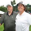 Jim Justice, owner and chairman The Greenbrier Resort, left, and Phil Mickelson, on the first hole during The Greenbrier Classic Pro-Am held on the Old White course Wednesday afternoon.<br /> Rick Barbero/The Register-Herald