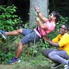 Alpine Ministries staff member Sergio Urias, left, and camper Amara Kromah,right, team up to tackle the advanced climbing wall during activities at the Alpine Ministries of Appalachian Bible College. F. Brian Ferguson/The Register-Herald