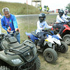 Jun Villegas, ATV safety instructor, second from left, goes over some safety procedures with venturing scouts during the National Boy Scout Jamboree at the new Summit Bechtel Family National Scout Reserve in Mt. Hope, WV<br /> Rick Barbero/The Register-Herald