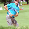 Bubba Watson hits out of the trap on the 11th hole during the first round of The Greenbrier Classic Thursday on the Old White TPC Course at The Greenbrier Resort in White Sulphur Springs.<br /> Rick Barbero/The Register-Herald