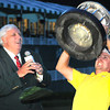 Jim Justice, Chairman and CEO, watches Jonas Blixt lift up the trophy after winning The Greenbrier Classic Sunday on the Old White TPC Course at The Greenbrier Resort in White Sulphur Springs.<br /> Rick Barbero/The Register-Herald